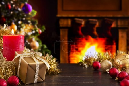 Christmas scene with fireplace and Christmas tree in the backgro