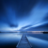 Jetty on a lake at dawn, near Amsterdam The Netherlands