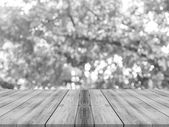 Wooden board empty table in front of blurred background. Perspective grey wood over blur trees in forest - can be used for display or montage your products. Tree silhouette. vintage filtered image.