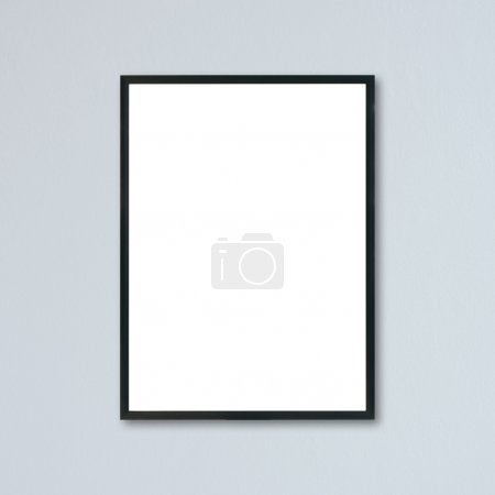 Mock up blank frame hanging on wall in room