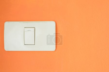 Photo for White light switch, turn on or turn off the lights on orange wall. - Royalty Free Image