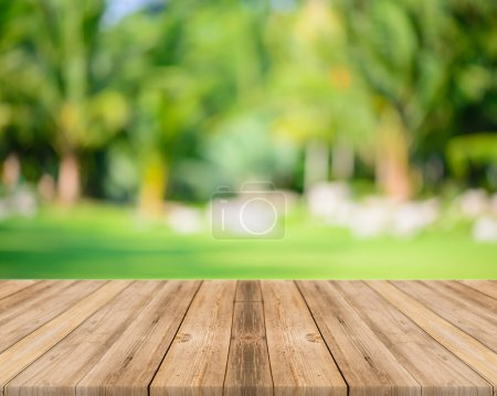Photo for Wooden board empty table in front of blurred background. Perspective grey wood over blur trees in forest - can be used for display or montage your products. spring season. vintage filtered image. - Royalty Free Image