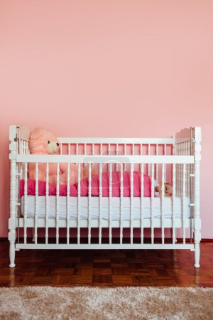 Baby girl sleeping in his bed