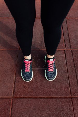 Woman's legs in running shoes