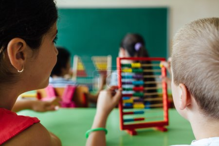 Photo for Children working with abacus in the classroom - Royalty Free Image