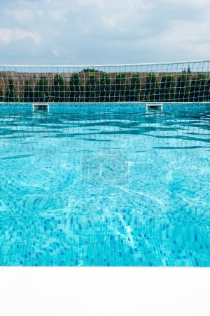 Photo for Swimming pool with a volleyball net, copy space - Royalty Free Image