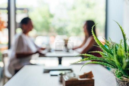 Two women talking in cafe.