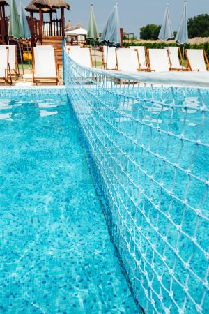 Photo for Water volleyball net in swimming pool, summertime - Royalty Free Image