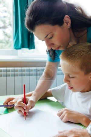 Teacher teaches child