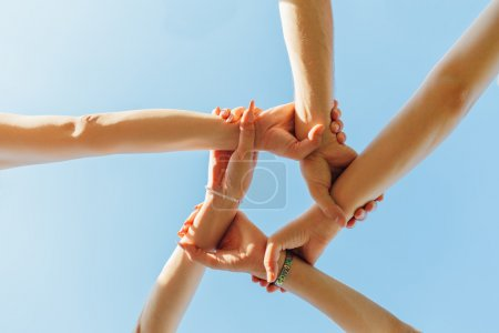 Photo for Girls holding hands showing unity - Royalty Free Image