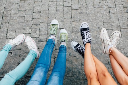 Photo for Girls are having fun with feet and shoes - Royalty Free Image