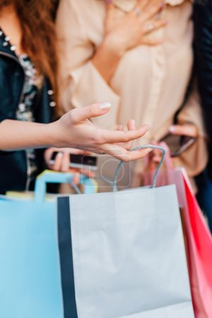 Closeup of girl opens the shopping bag