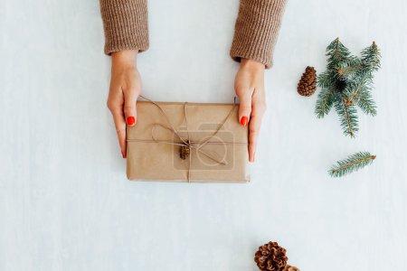 Top view of Woman preparing Christmas gift