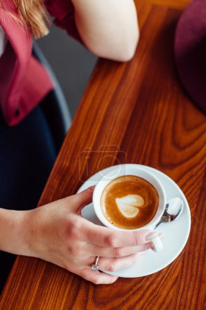 Woman love coffee with heart shape