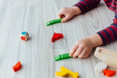 Closeup of kid playing with toys