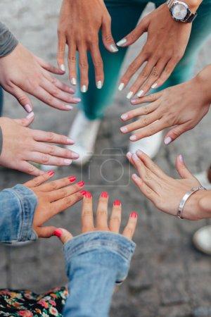 Teenage girls showing hands