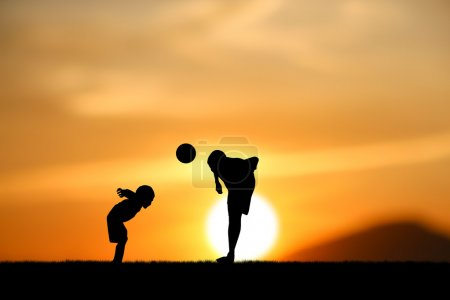 Photo for Silhouette two brothers, boys play football at sunset. - Royalty Free Image