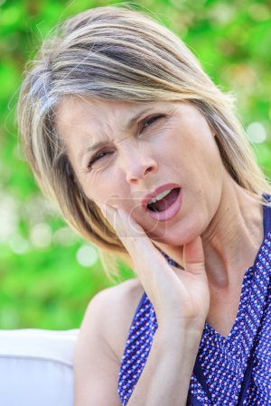 attractive woman suffering teeth strong pain