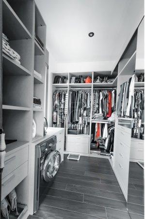 Walk-in closet. Wardrobe with organized clothing