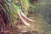 Bare feet of the river. A child enjoying the outdoors.