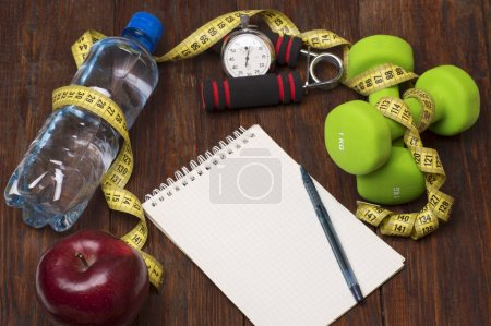 Workout and fitness dieting copy space diary. Healthy lifestyle concept.