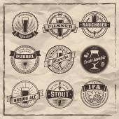 Craft beer labels Traditional german belgian and british beer styles Weissbier pilsner rauchbier dubbel blanche fruit lambic brown ale stout and IPA Vintage craft beer emblems on a paper background