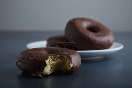 Unfocused choco donuts and focused bite