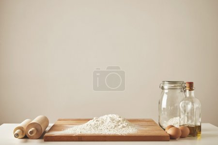 rolling pin olive oil flour isolated on white