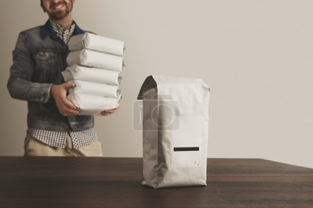 Bigh blank package presented in front unfocused happy loader bag