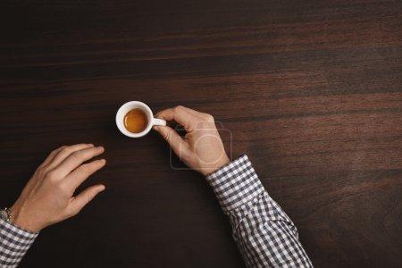 Businessman hands in plaid dress shirt wear luxury watches with espresso