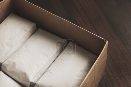 opened big carton box full of blank hermetic white packages
