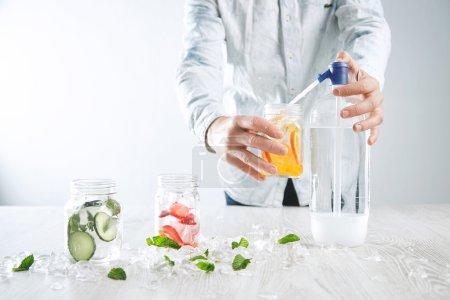 Bartender makes homemade lemonade