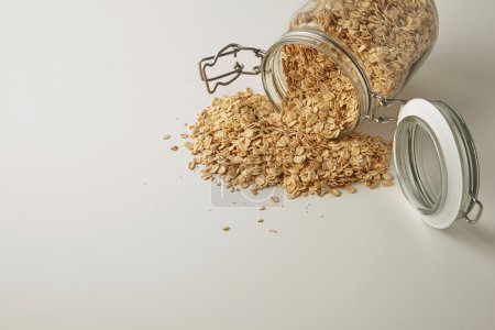 full opened rustic jar with healthy rolled oats