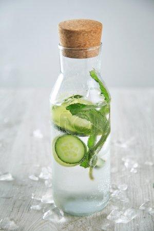 bottle filled with cold fresh cucumber lemonade