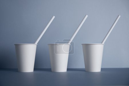 Three take away white paper cups