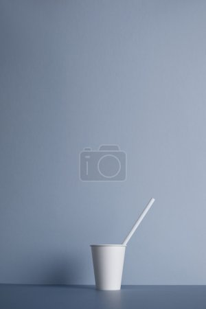 White paper cups isolated on gray
