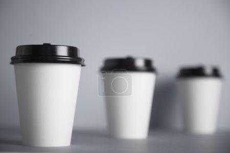 Three take away white paper cups