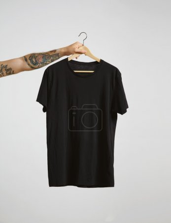 hand holds hang with black t-shirt