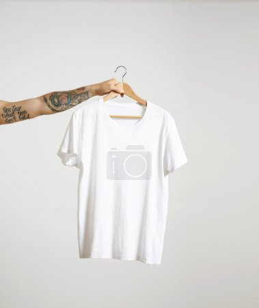 hand holds hang with white t-shirt