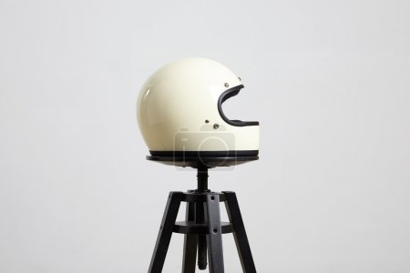 Motorbike helmet on chair right side