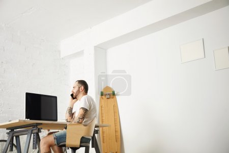 freelancer talks on mobile phone