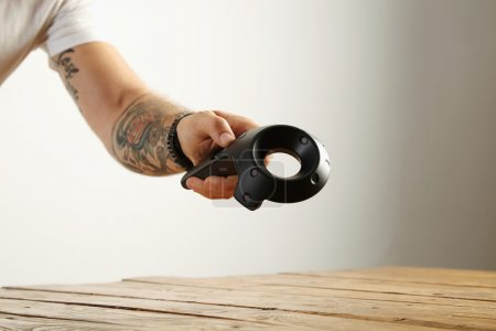 Tattooed hand gives virtual controller