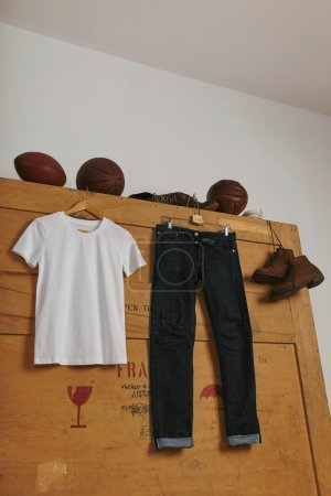 t-shirt and jeans on wooden box with play balls