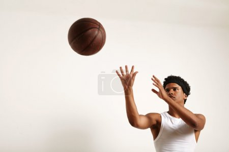 African American player throwing a vintage ball
