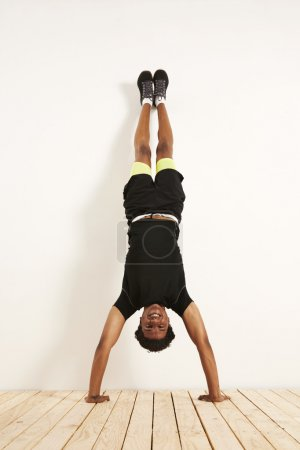 athlete doing handstand