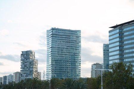 City buildings against white sky