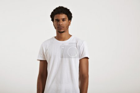 Photo for Fit and sexy young black man with an afro wearing a clean unlabeled white t-shirt - Royalty Free Image