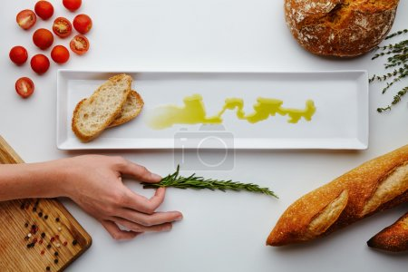 composition with bread, olive oil, tomatoes cherry, pepper
