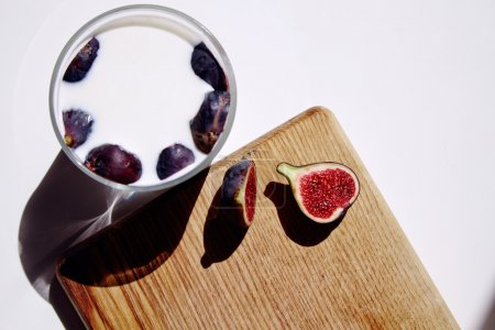 Glass with milk and figs