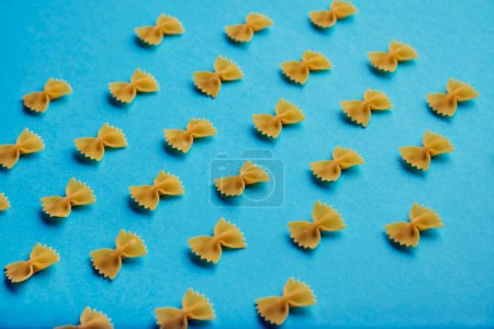 Farfale pasta pattern on turquoise background side view